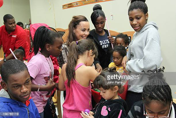 Adrienne Bosh with the Chapman Partnership kids to help feed the local families of Miami this Thanksgiving at Chapman Partnership on November 20 2012...