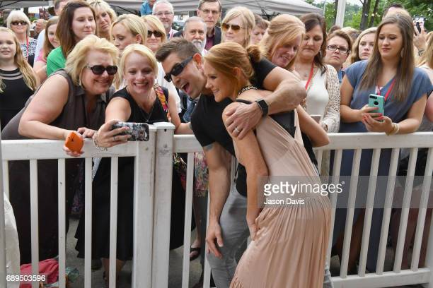 Adrienne Camp and Jeremy Camp pose with fans at the 5th Annual KLOVE Fan Awards at The Grand Ole Opry on May 28 2017 in Nashville Tennessee