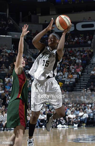 Adrienne Goodson of the San Antonio Stars goes up for the shot past Sue Bird of the Seattle Storm during the WNBA game at SBC Center on May 24 2003...