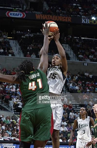 Adrienne Goodson of the San Antonio Stars shoots a jump shot over Alisa Burras of the Seattle Storm during the WNBA game at SBC Center on May 24 2003...