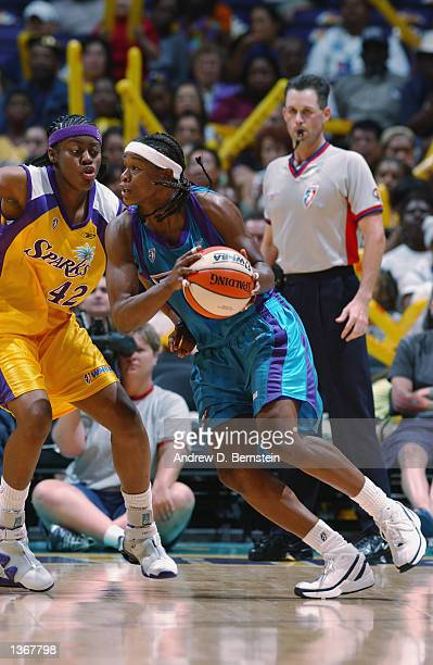 Adrienne Goodson of the Utah Starzz drives past Nikki Teasley of the Los Angeles Sparks in Game two of the Western Conference Finals during the 2002...