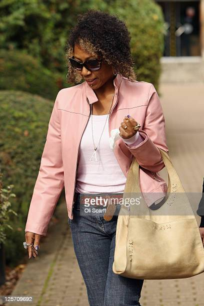 Adrienne Ives the mother of Chelsea Ives leaves Wood Green Crown Court after her daughter pleaded guilty to criminal charges from last month's riots...