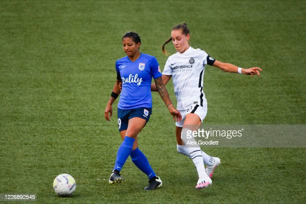 Adrienne Jordan of OL Reign attempts to pass away from Celeste Boureille of Portland Thorns FC during a game on day 8 of the NWSL Challenge Cup at...