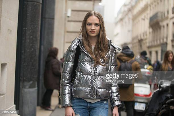 Adrienne Jueliger wears a silver puffer jacket after the Elie Saab show on January 25 2017 in Paris France