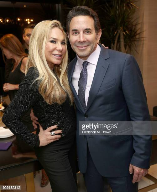 Adrienne Maloof and Dr Paul Nassif arrive for Dr Paul Nassif unveils his new medical spa with grand opening and ribbon cutting ceremony on March 7...