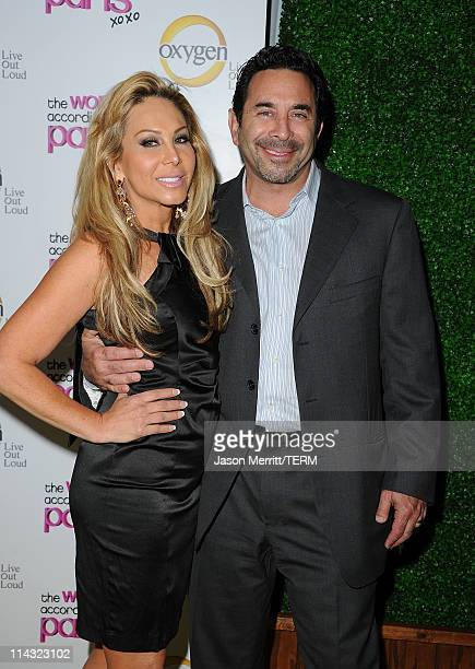 Adrienne Maloof and husband Dr Paul Nassif arrive at the premiere of Oxygen's new docuseries The World According to Paris at Tropicana Bar at The...
