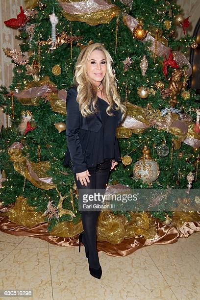 Adrienne Maloof poses for a photo at her Annual Holiday Party with Never Too Hungover on December 24 2016 in Beverly Hills California