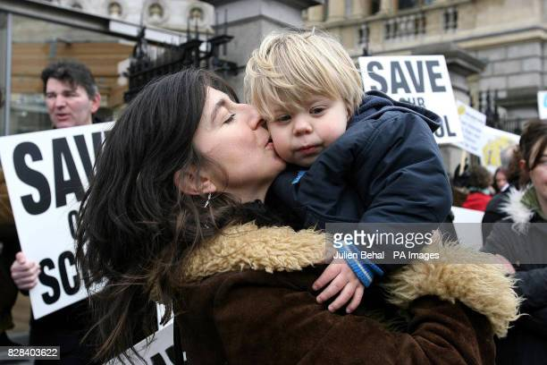 Adrienne Murphy kisses her son Caoimh Connolly who has autism at the protest outside the Government Buildings in Dublin Tuesday March 21 2006 The...