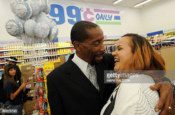 Adrienne Rounds and Brad Pye kiss after their 99 cent wedding ceremony at the 99 cent store in Los Angeles on September 9 2009 The budget supermarket...
