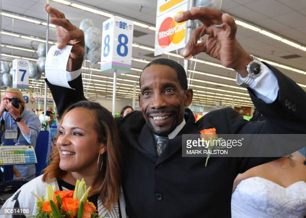Adrienne Rounds and Brad Pye show the receipt and penny change for their 99 cent wedding ceremony at a checkout at the 99 cent store in Los Angeles...