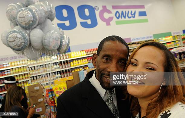 Adrienne Rounds and Brad Pye smile after their 99 cent wedding ceremony at the 99 cent store in Los Angeles on September 9 2009 The budget...
