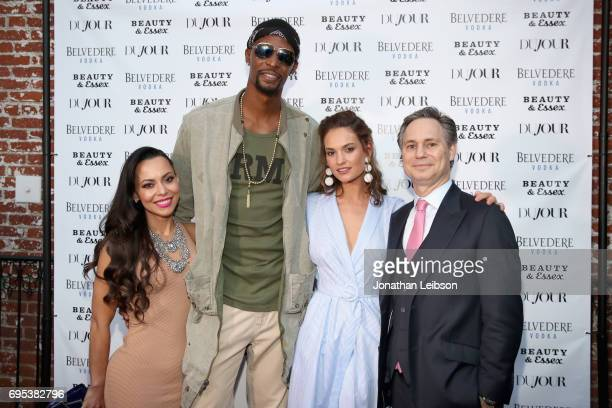 Adrienne Williams Bosh NBA player Chris Bosh actor Lily James and CEO Founder of DuJour Niche Media Jason Binn attend DuJour's Summer Issue Cover...