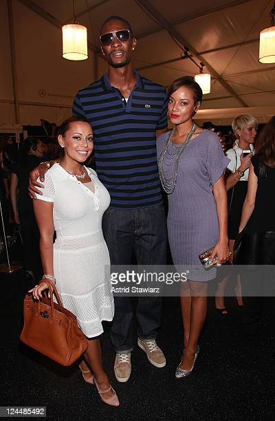 Adrienne Williams NBA player Chris Bosh and model Selita Ebanks pose backstage at the Lacoste Spring 2012 fashion show during MercedesBenz Fashion...