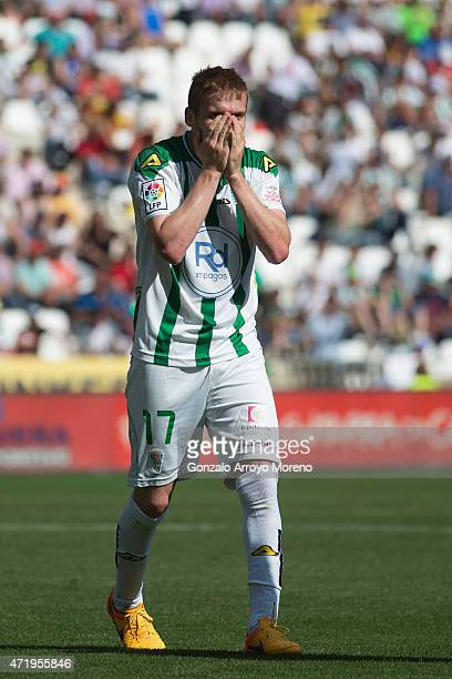 Adrin Gunino of Cordoba CF reacts after tackling Neymar JR of FC Barcelona during the La Liga match between Cordoba CF and Barcelona FC at El...