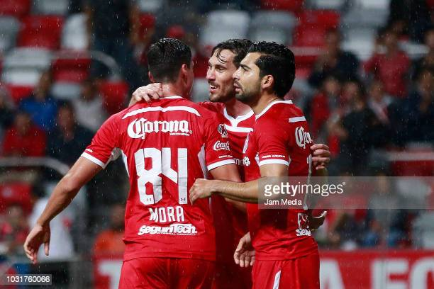 Adrián Mora of Toluca celebrates with teammates after scoring the first goal of his team during a group B match between Toluca and Tijuana as part of...