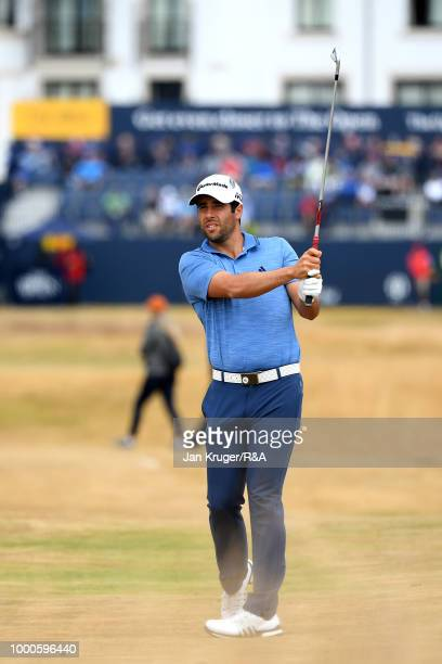 Adrián Otaegui of Spain plays his second shot at the 1st hole while practicing during previews to the 147th Open Championship at Carnoustie Golf Club...
