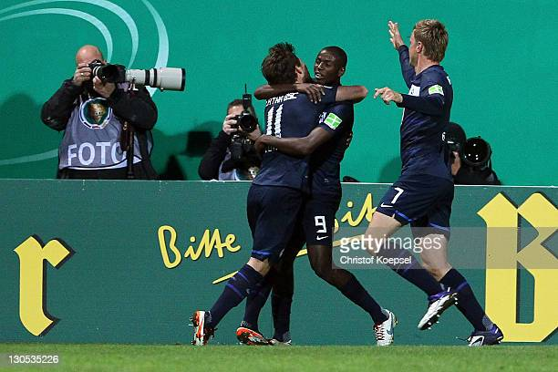 Adrián Ramos celebrates the first goal with Tunay Torun and Maik Franz of Berlin during the second round DFB Cup match between RotWeiss Essen and...
