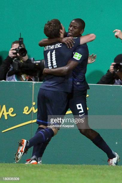 Adrián Ramos celebrates the first goal with Tunay Torun of Berlin during the second round DFB Cup match between RotWeiss Essen and Hertha BSC Berlin...
