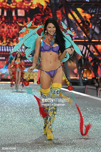 Adrina Lima walks the runway at the Victoria's Secret Fashion Show on November 30 2016 in Paris France