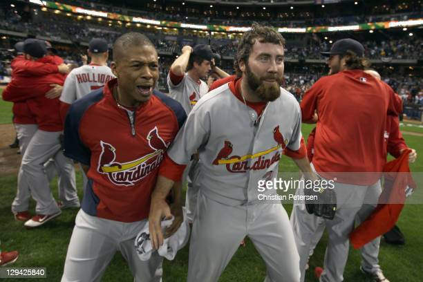 Adron Chambers and Jason Motte of the St Louis Cardinals celebrate on the field after they won 126 against the Milwaukee Brewers during Game Six of...