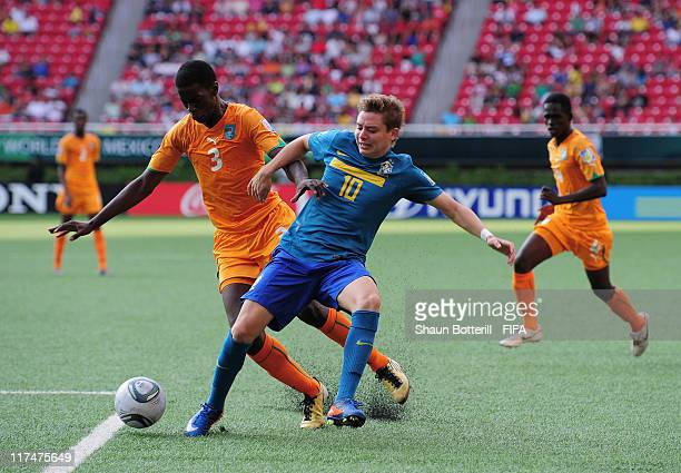 Adryan of Brazil is tackled by Mory Kone of Ivory Coast during the FIFA U-17 World Cup Group F match between Ivory Coast and Brazil at Estadio...