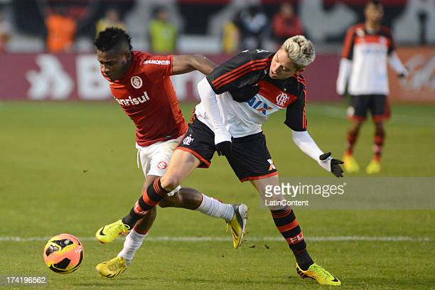 Adryan of Flamengo fights for the ball with Willians of Internacional during a match between Flamengo and Internacional as part of the Brazilian...