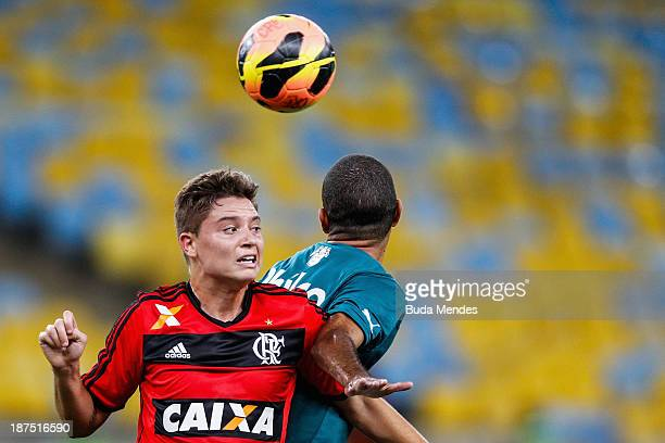Adryan of Flamengo struggles for the ball during the Brazilian Series A 2013 between Flamengo and Goias at Maracana on November 9, 2013 in Rio de...