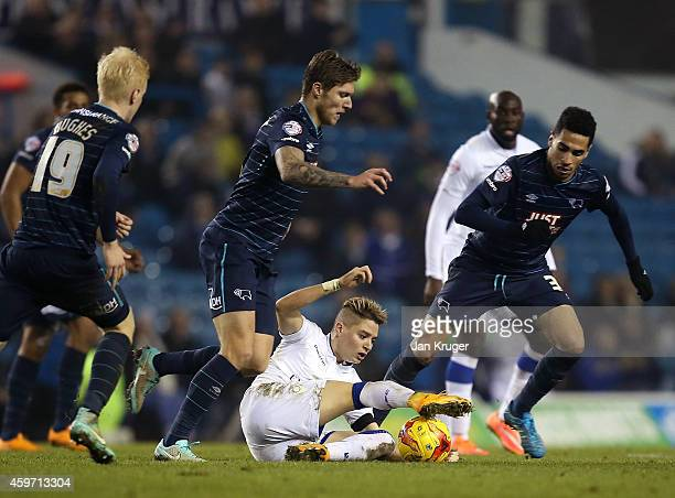 Adryan of Leeds controls the ball off his feet under pressure from Jeff Hendrick of Derby County during the Sky Bet Championship match between Leeds...