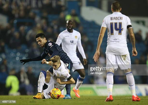 Adryan of Leeds is challenged by Omar Mascarell of Derby County during the Sky Bet Championship match between Leeds United and Derby County at Elland...