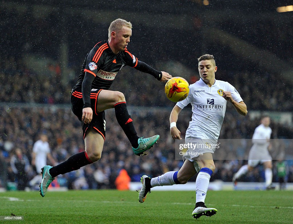 Adryan (R) of Leeds United looks on as Jack Grimmer of Fulham clears the ball up field during the Sky Bet Championship match between Leeds United and Fulham at Elland Road on December 13, 2014 in Leeds, England.