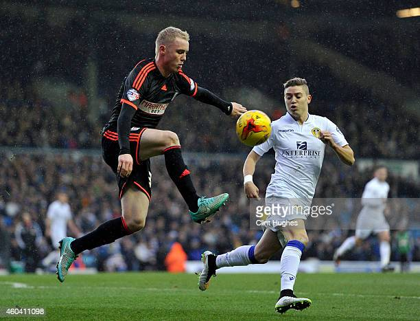 Adryan of Leeds United looks on as Jack Grimmer of Fulham clears the ball up field during the Sky Bet Championship match between Leeds United and...