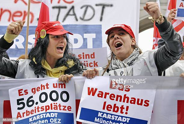 ADDITION ads photographer byline Employees of German retailers Karstadt and Kaufhof hold posters reading 'It's a question of 56000 jobs' and 'The...