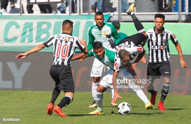 Adson of Brazilian club Atletico Mineiro is upended by Gustavo Torres of Colombian side Atletico Nacional during their Florida Cup soccer game at...