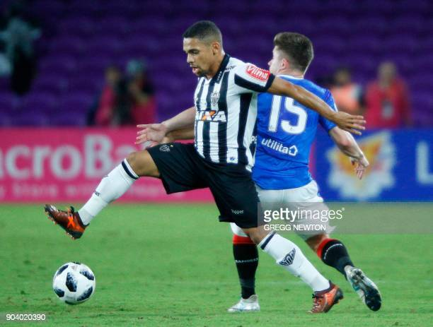 Adson of Brazilian club Atletico Mineiro moves the ball ahead of Declan John of Scottish club Rangers FC during their Florida Cup soccer game at...