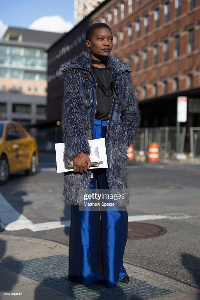 Adtresa Monique is seen attending Samuelsohn at The Rink wearing a Yuna Yang coat with Kent Stetson bag on January 30, 2017 in New York City.