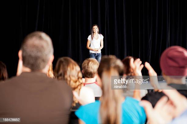 adudience clapping for a teenage girl on stage - awards ceremony stock pictures, royalty-free photos & images