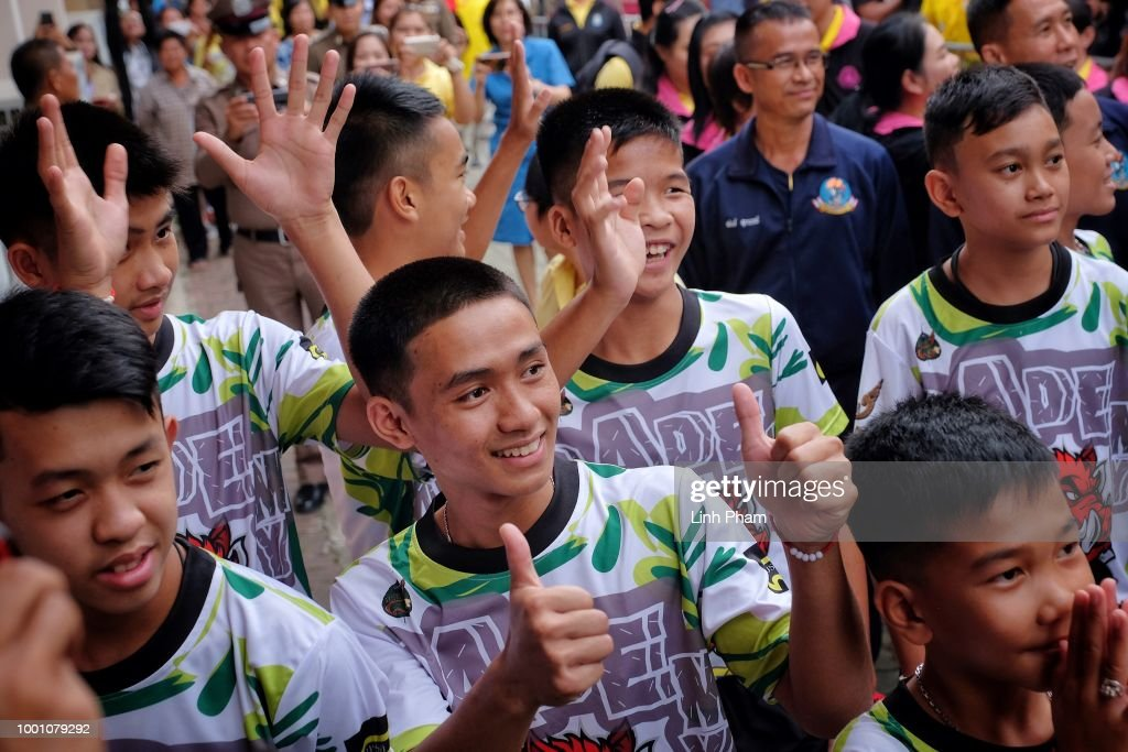 Twelve boys and their coach from the 'Wild Boars' soccer team arrive for a press conference for the first time since they were rescued from a cave in northern Thailand last week, on July 18, 2018 in Chiang Rai, Thailand. The 12 boys, aged 11 to 16, and their 25-year-old coach were discharged early from Chiang Rai Prachanukroh hospital after a speedy recovery and thanked those involved in their rescue.
