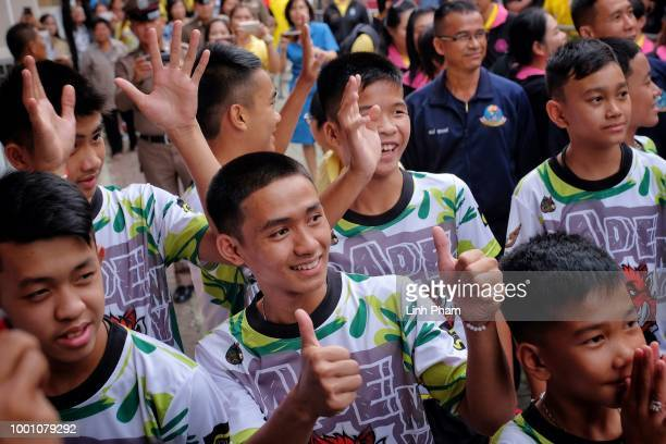 Twelve boys and their coach from the 'Wild Boars' soccer team arrive for a press conference for the first time since they were rescued from a cave in...