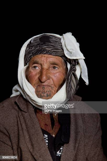 Adule Ali about 80 from Kobane Syria photographed at a refugee camp in Turkey 'When I was young a gypsy woman made my tattoos' said Adule As a young...