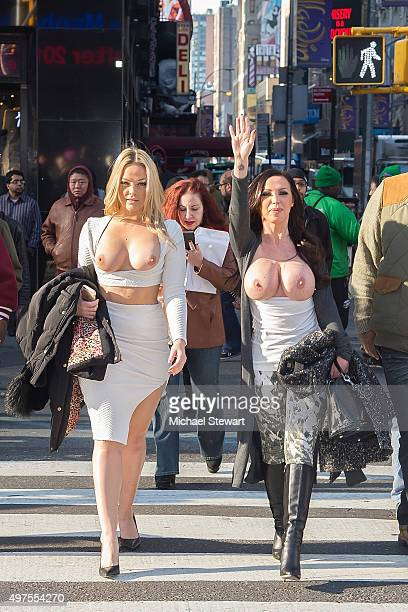 Adult actresses Alexis Texas and Nikki Benz walk topless through Times Square in celebration of gender liberation on November 17 2015 in New York City