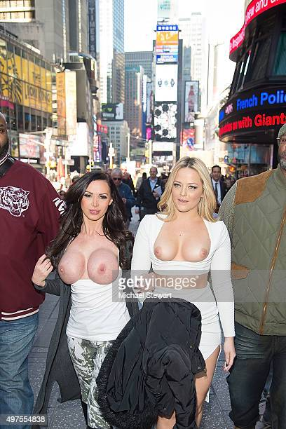 Adult actresses Nikki Benz and Alexis Texas walk topless through Times Square in celebration of gender liberation on November 17 2015 in New York City