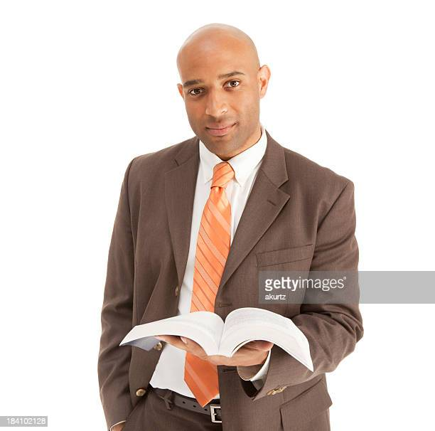 Adult African American male Minister Preacher Priest holding the Bible