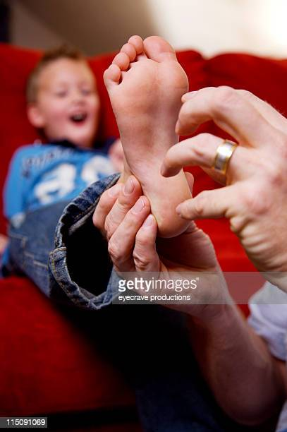 adult and adolescent portraits - tickling feet stock photos and pictures