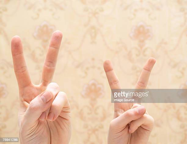 Adult and child doing peace signs