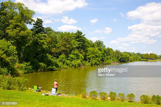 adult and child fishing in pond near ridgewood - ridgewood new jersey stock pictures, royalty-free photos & images