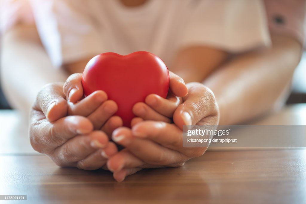 adult and child hands holding red heart, health care, donate and family insurance concept,world heart day, world health day, : Stock Photo