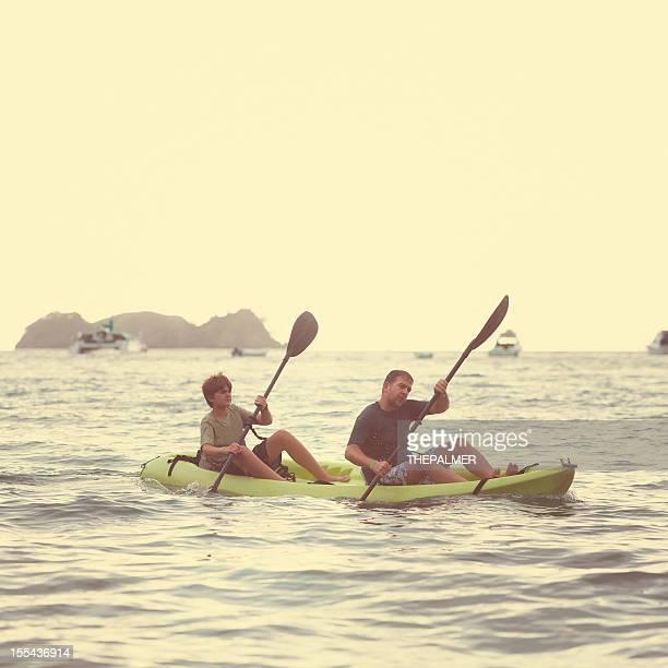 adult and kid kayaking
