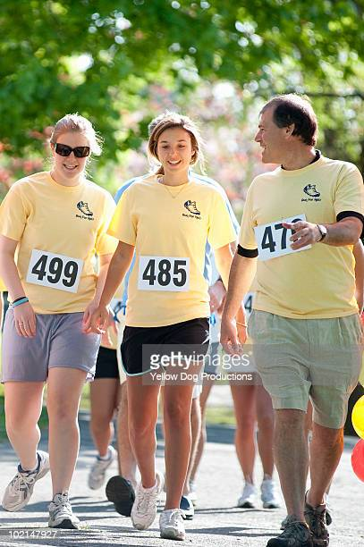 adult and teens walking in charity road race - salem massachusetts stock pictures, royalty-free photos & images