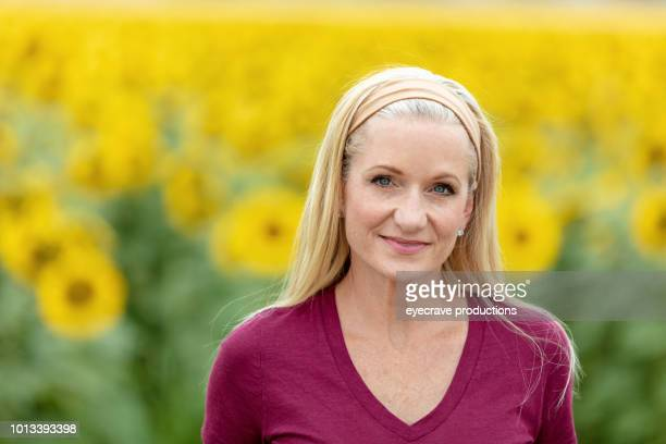 Adult Blonde Female In Vibrant Summer Sunflower Field Western Colorado Early August