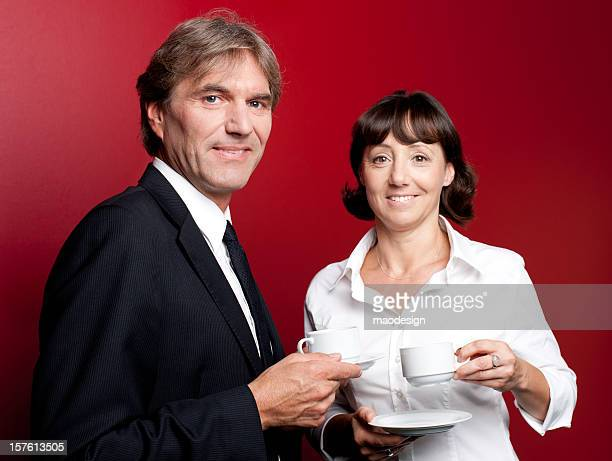 Adult Business Couple Drinking Coffee and Talking